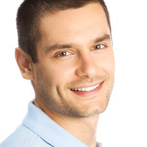 Man with a fresh haircut smiling